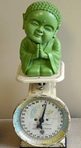 buddha on scale